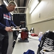 TORONTO, CANADA - DECEMBER 27: Russia's Equipment Manager Alexander Rezepov sharpens skates prior to Russia's game against Latvia in the preliminary round - 2017 IIHF World Junior Championship. (Photo by Matt Zambonin/HHOF-IIHF Images)