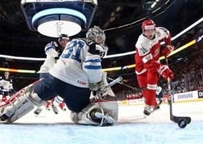 MONTREAL, CANADA - DECEMBER 27: Denmark's William Boysen #18 scores a first period goal against Finland's Veini Vehvilainen #31 during preliminary round action at the 2017 IIHF World Junior Championship. (Photo by Andre Ringuette/HHOF-IIHF Images)