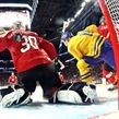 MONTREAL, CANADA - DECEMBER 28: Switzerland's Joren van Pottelgerghe #30 can't make the save on this play as Sweden's Joel Eriksson Ek #20 scores a first period goal to give his team a 1-0 lead during preliminary round action at the 2017 IIHF World Junior Championship. (Photo by Andre Ringuette/HHOF-IIHF Images)