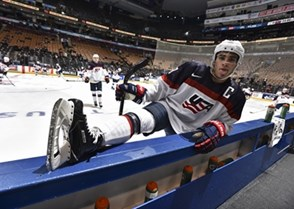 TORONTO, CANADA - DECEMBER 28: USA's Luke Kunin #9 sticks his tongue out while stretching by the bench during warm up before taking on Slovakia in the preliminary round of the 2017 IIHF World Junior Championship. (Photo by Matt Zambonin/HHOF-IIHF Images)
