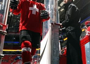 MONTREAL, CANADA - DECEMBER 30: Switzerland's Jerome Portmann #8 leaves the ice after warm-up prior to preliminary round action against Denmark at the 2017 IIHF World Junior Championship. (Photo by Francois Laplante/HHOF-IIHF Images)