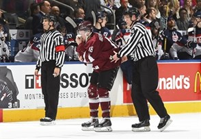 TORONTO, CANADA - DECEMBER 30: Latvia's Ricards Bernhards #18 heads to his bench with the help from  Linesman Sakari Suonminen #66 after a bodycheck into the boards resulted in a nosebleed in the first period during preliminary round action at the 2017 IIHF World Junior Championship. (Photo by Matt Zambonin/HHOF-IIHF Images)