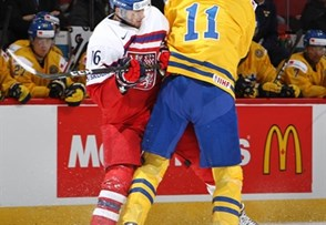 MONTREAL, CANADA - DECEMBER 31: The Czech Republic's Daniel Kurovsky #16 takes a hit from Sweden's Filip Ahl #11 during preliminary round action at the 2017 IIHF World Junior Championship. (Photo by Francois Laplante/HHOF-IIHF Images)