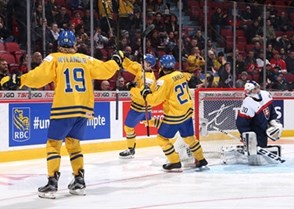 MONTREAL, CANADA - JANUARY 2: Sweden's Joel Eriksson Ek #20 celebrates a first period goal against Slovakia's Adam Huska #30 with teammates Alexander Nylander #19 and Jonathan Dahlen #27 while Michal Roman #5 looks on during quarterfinal round action at the 2017 IIHF World Junior Championship. (Photo by Andre Ringuette/HHOF-IIHF Images)