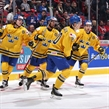 MONTREAL, CANADA - JANUARY 2: Sweden's Joel Eriksson Ek #20 celebrates a first period goal against Slovakia'swith teammates Alexander Nylander #19, Oliver Kylington #7 and Rasmus Asplund #18 during quarterfinal round action at the 2017 IIHF World Junior Championship. (Photo by Andre Ringuette/HHOF-IIHF Images)