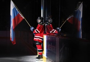 MONTREAL, CANADA - JANUARY 5: Team Russia flag bearer awaits the arrival of the Russia players prior to bronze medal game action against Sweden at the 2017 IIHF World Junior Championship. (Photo by Andre Ringuette/HHOF-IIHF Images)